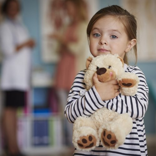 Little girl holding teddy